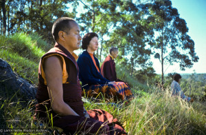 (15969_sl.JPG) Lama Yeshe, Beatrice Ribush, and Lama Zopa Rinpoche in meditation. On Saka Dawa (the celebration of Buddha's birth, enlightenment, and death), Lama Yeshe asked everyone to come outside after a Guru Puja for a meditation on the hill behind the gompa. Chenrezig Institute, Australia, May 25, 1975. Photo by Wendy Finster.